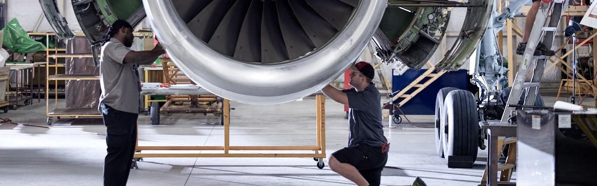 Men working on airplane propeller