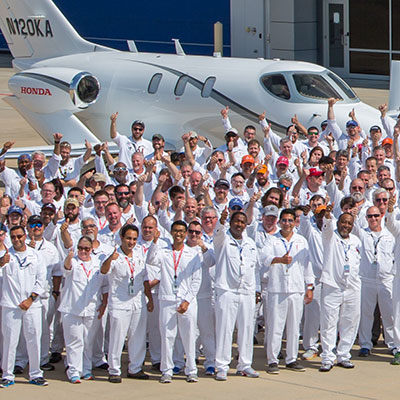 Honda Aircraft Company employees in front of HondaJet