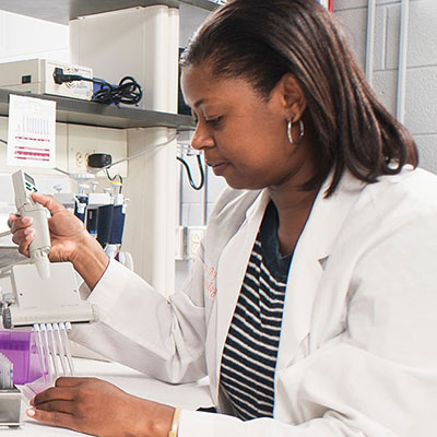 Woman conducting lab work